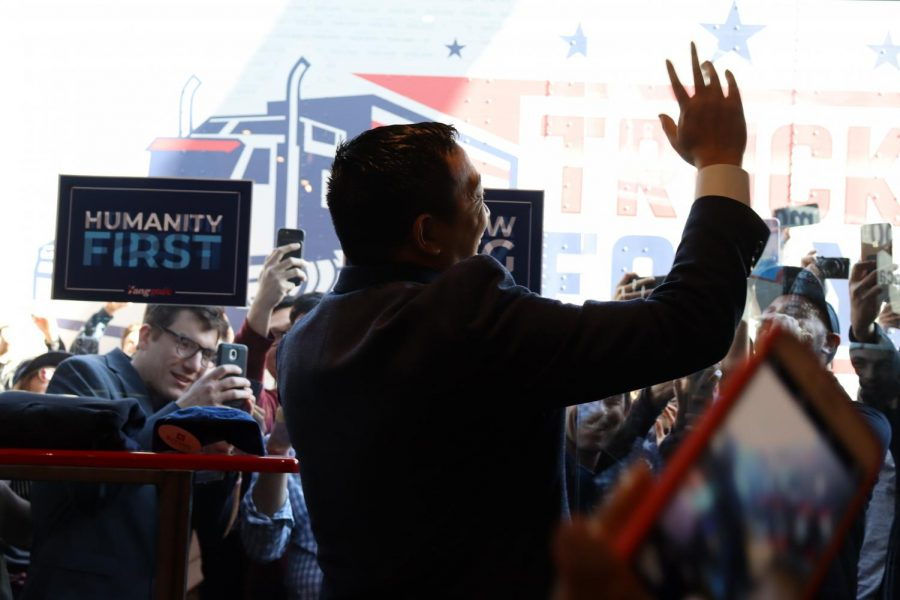 "CLOSE: Andrew Yang, candidate for the 2020 Democratic presidential nomination, waved to a cheering crowd outside of Tried and True Co. vintage clothing store on Fairfax Avenue just north of school Dec. 19. The storefront had been completely revamped with Yang hats, sweatshirts and other ""merch,"" and some of the crowd had arrived at 6 a.m., as they might for a drop of rare clothing from a popular manufacturer."