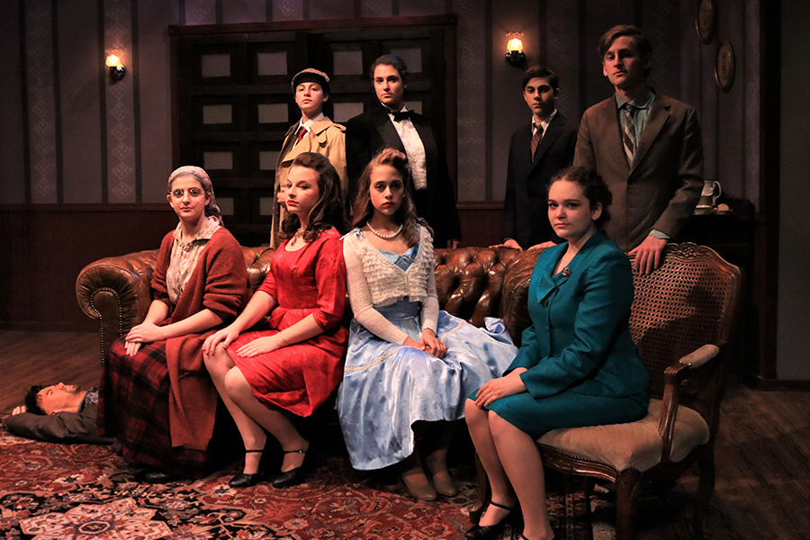 MYSTERY: The cast of Shalhevet Drama's fall mainstage sought a murderer while making larger points about the dramatic and journalistic arts.  Clockwise from far left, Lehava Segal, Hannah Poltorak, Rebecca Cohen, Zach Rub, Jacob Lefkowitz Brooks, Ariel Urman, Zoe Ritz and Neima Fax.