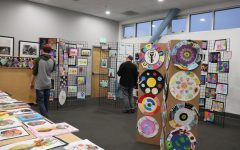 POP-UP: Student art at Shalhevet is displayed on the walls in the circular stairway and on bulletin boards around school for everyday visibility. But the art show displayed the student artwork on racks in room 304.