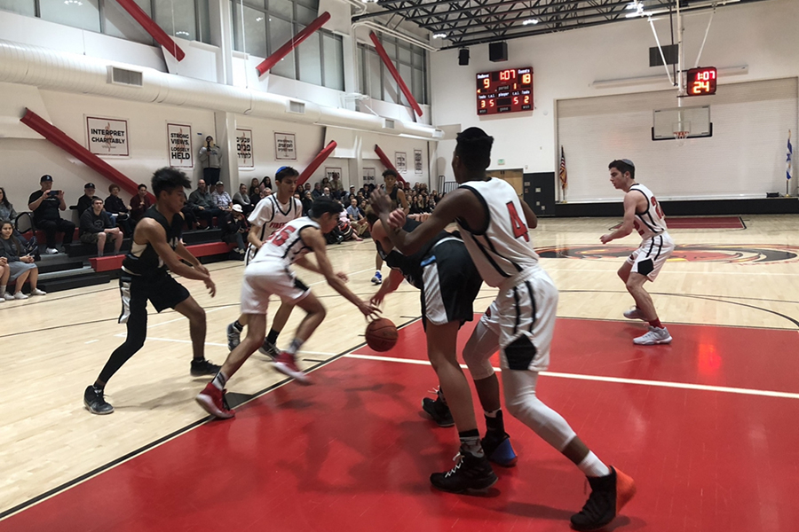 FIGHT%3A+Firehawk+and+Bulldog+players+scramble+for+ball+possession+at+the+opening+game+of+the+CIF+Southern+Section+playoffs+Feb.12.+Shalhevet+prevailed+68-59+against+Buena%2C+a+team+that+beat+them+by+14+in+December.