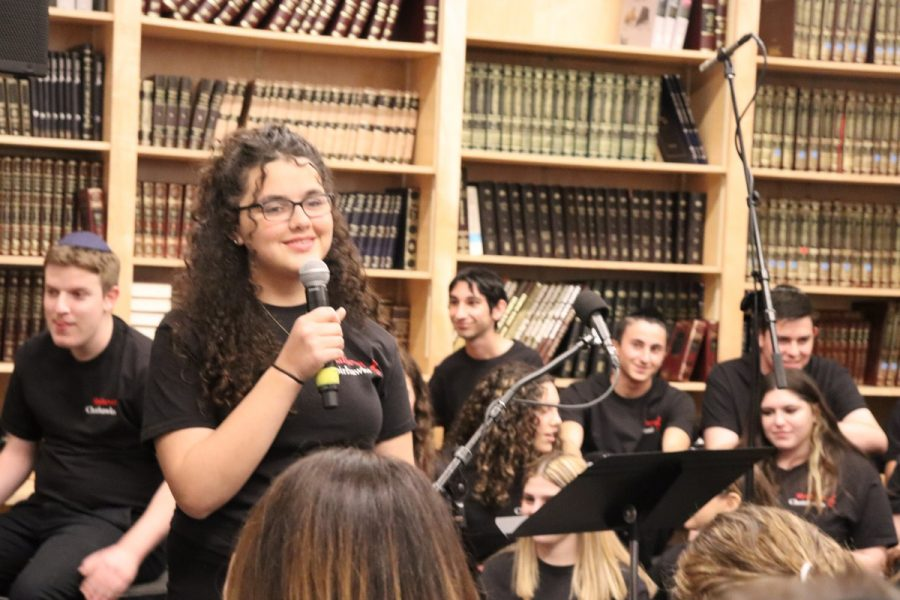 """Sophomore Talya Kukurudz sang """"Make you feel my love,"""" by Bob Dylan, one of two solo performances in the Choirhawks """"Back from the Bay"""" performance on Dec. 18."""