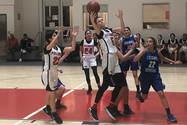 BOARD: Senior center Elianna Kupferman secures an offensive rebound in the Firehawks' 64-28 over the Cal Lutheran C-Hawks Feb. 13. Shalhevet has advanced to the second round of the CIF Division 4A playoffs, and will face off against Mary Star of the Sea on Monday night at the Shalhevet gym.