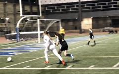 PURSUIT: Freshman forward Vivienne Schlussel charges the ball as a YULA defender trails her. The Firehawks went on an offensive tirade last week, beating the Panthers 8-0 ahead of their playoff game versus Buckley tomorrow.