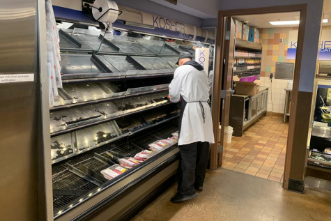 ADJUST: Kosher meat cases were empty at Ralph's on LaBrea March 15 as consumers rushed to buy products before countywide stay-at-home orders were issued, though workers had assured shoppers they would be restocked the next day.