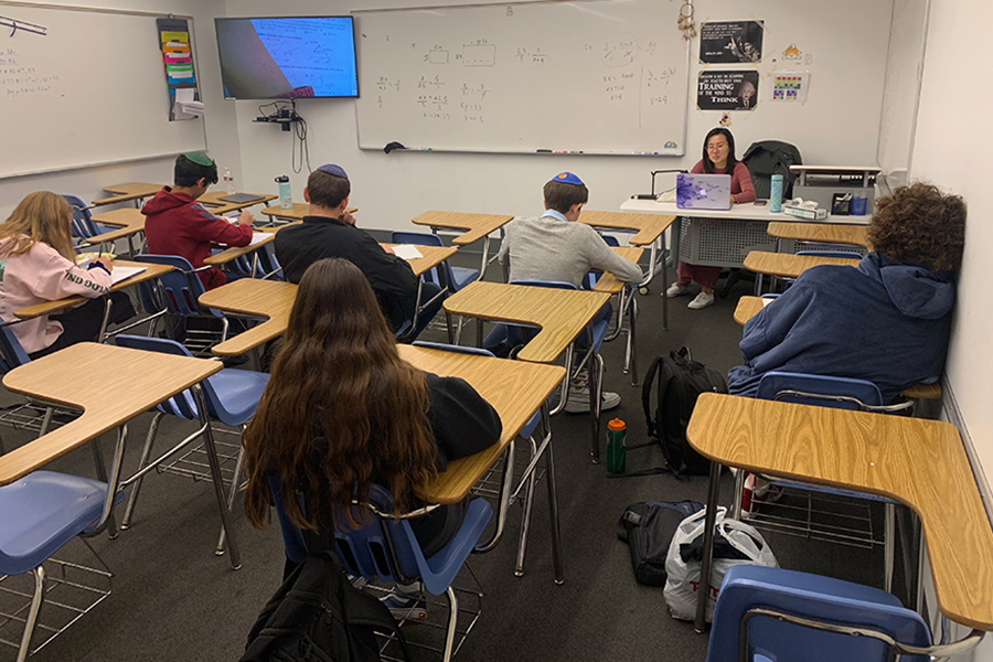 """EMPTY: On Thursday in Ms. Kong's ninth-grade geometry class, only 7 of 14 students showed up. Rabbi Segal had told parents in an email the night before that if they wanted their child to stay home as an extra precaution, it would """"be considered an excused absence."""""""