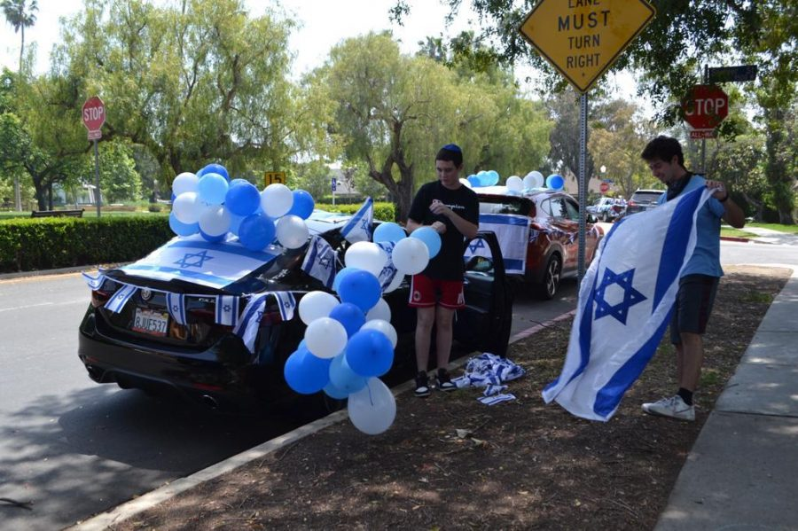 DECORATIONS: Seniors Ben-Tsion Oliel and Noah Hertzberg plastered their cars with Israeli flags and blue and white balloons before the parade. The goal was to celebrate while observing social distancing.