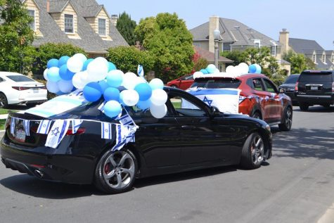 DIFFERENT: Seniors and a few faculty drove down Cresta Drive in the Yom Haatzmaut car parade April 29. A total of 46 vehicles joined the line, which zig-zagged for 4.9 miles.