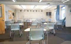 SAFETY: Plexi-glass dividers built by Maintenance Head Jose Flores have been installed around desks in larger classrooms.
