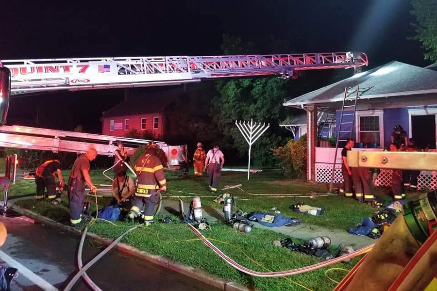 FIRE: Emergency personnel worked to extinguish an arson fire Aug. 25 at the Chabad Jewish Center in Newark, Del., which serves the University of Delaware's Newark campus.
