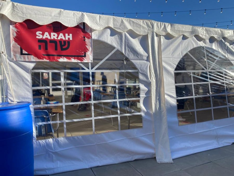 NAMES: New tents set up to accommodate in-person outdoor learning are named after the patriarchs and matriarchs. Tents Sarah and Abraham are on the third-floor patio; tents Leah, Yaakov, and Rachel are on the turf; and tents Yitzchak and Rivka are in the parking lot.