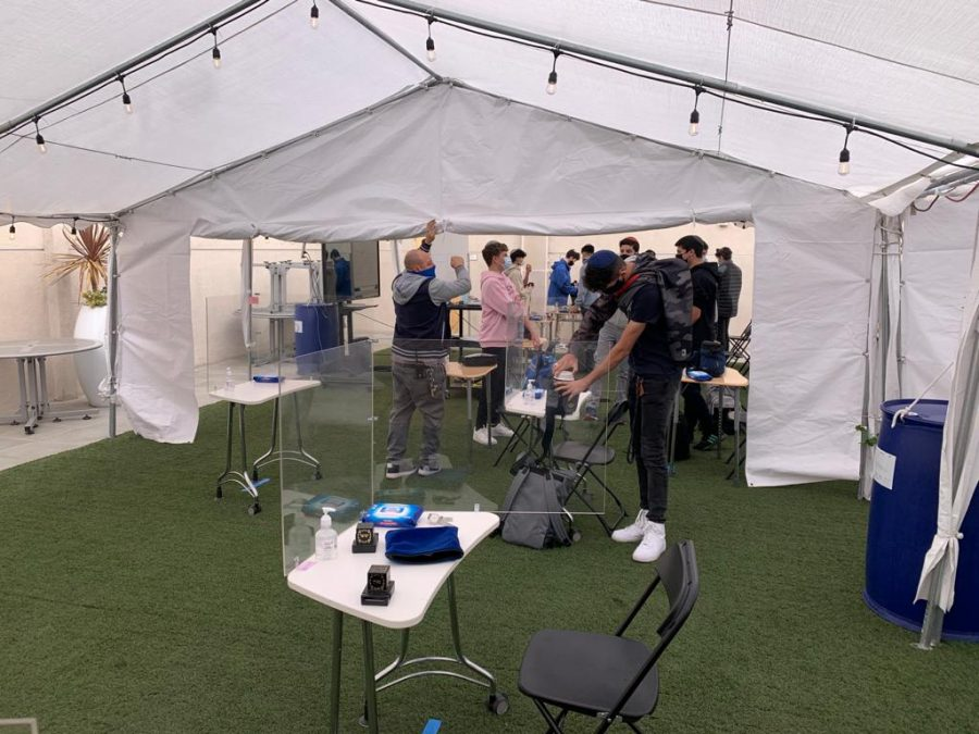 SPACE: To accommodate the increased number of students on campus, the sides of the Rachel, Yaakov and Leah tents were rolled up to create one large space for davening.