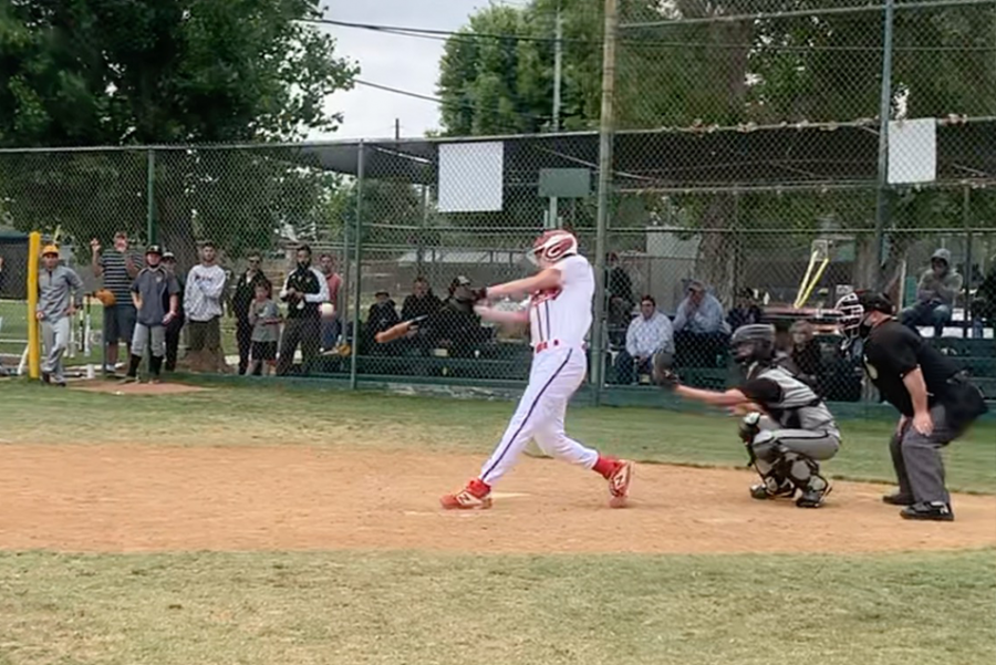 SWING: Above, Josh Harrison hits a game-ending single to left centerfield at the bottom of the seventh inning at East Valley Baseball Fields last Sunday