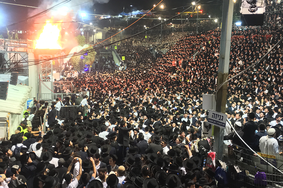 BEFORE: Thousands of an estimated 100,000 Haredim and others at Mount Meron sang and swayed together around a huge Lag B'Omer bonfire April 30.