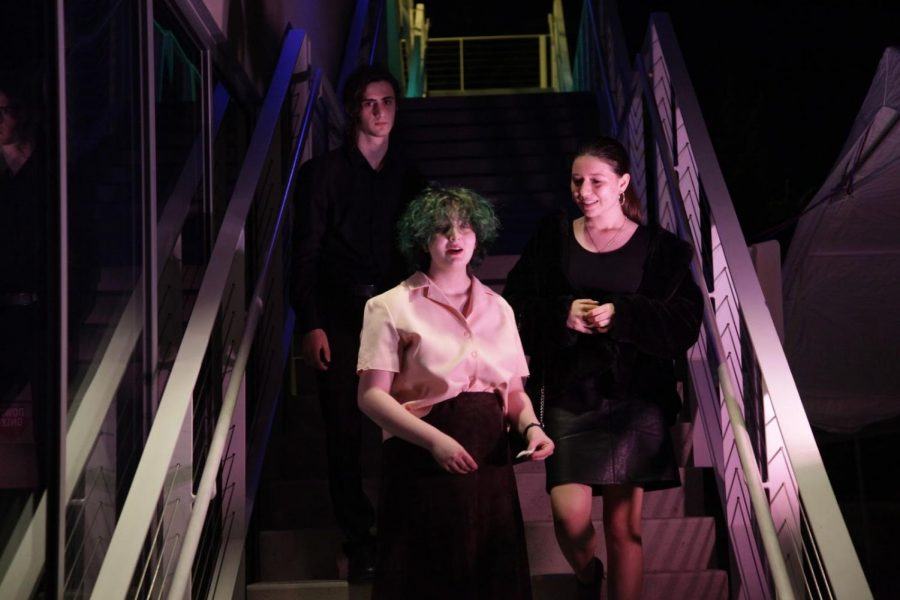OUTSIDE: Dallas Corn, Gitty Rav-Noy and Natalie Harkham created a scene involving a married couple, performed on the parking lot stairs.