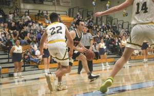 AGGRESSIVE: Senior Ze'ev Remer dribbles into the paint in a hard-fought CIF semifinals game against the Marina Vikings. He scored 37 points in the game at Marina High School in Huntington Beach.