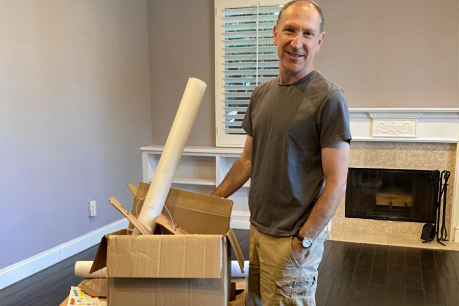 MOVING: Mr. Diamond got boxes ready for his cross-country move last week. He and his family are relocating to his home city of Philadelphia.
